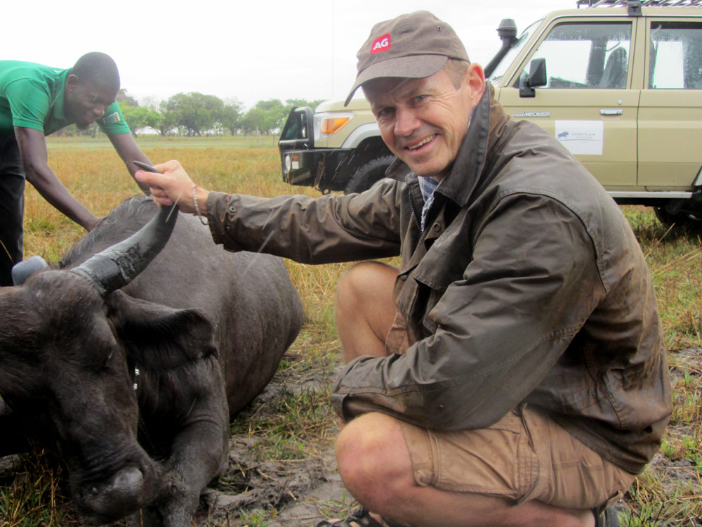 Simon with a buffalo at a visit to Lumei Primary School in Zambia's National Park
