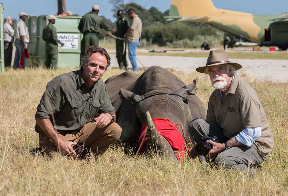 Joss Kent and Derek Joubert at the release of rhinos in Botswana – courtesy of David Murray