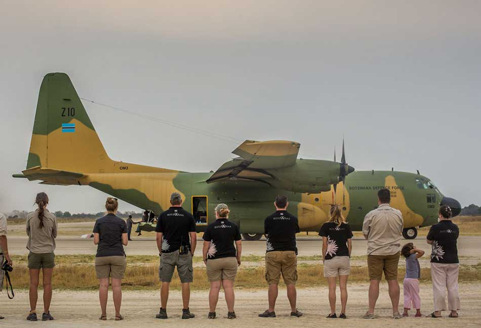 Rhino Without Borders team standing in front of the BDF C130 aircraft – courtesy of Wayne Raymond